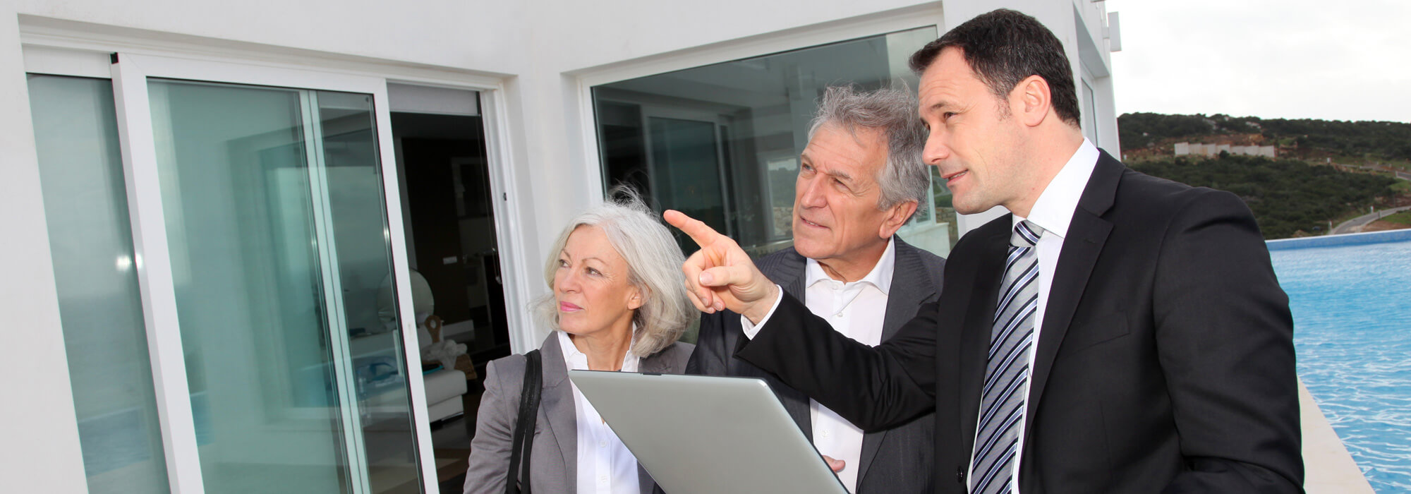 Buying Property Checklist - Header Image - Couple looking at buying property